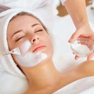 Woman in mask on face in spa beauty salon